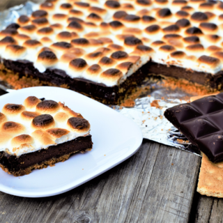 Easy way to enjoy all the goodness of s'mores from your kitchen! Golden-brown-slightly-charred marshmallows melt over rich chocolate ganache.
