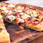 Let's just slow down and savor these beautiful words: jalapeño. bacon. cream cheese. pizza. Yep, this is definitely all kinds of good.