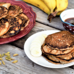 Banana pancakes are melt-in-your-mouth moist, generously spiced & perfectly paired with a simple honey syrup steeped with cardamom and vanilla.