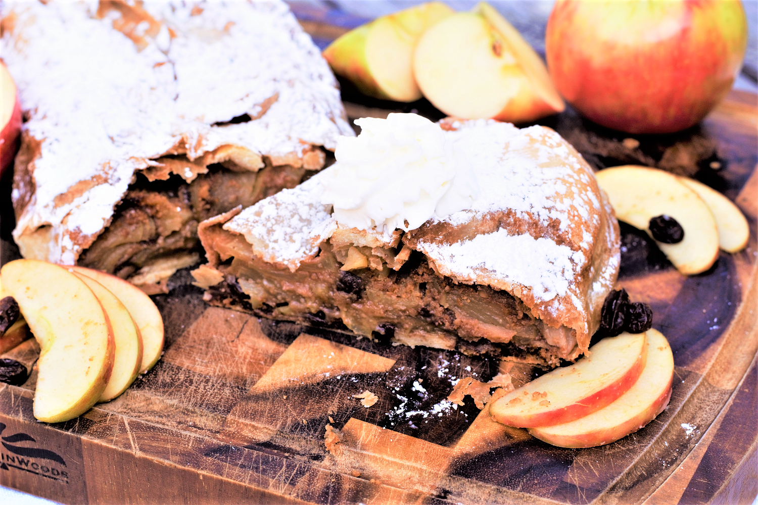 Sweet, flaky apftelstrudel with thinly sliced apples, rum-soaked raisins, & sugary toasted breadcrumbs is the very best way to celebrate Oktoberfest!