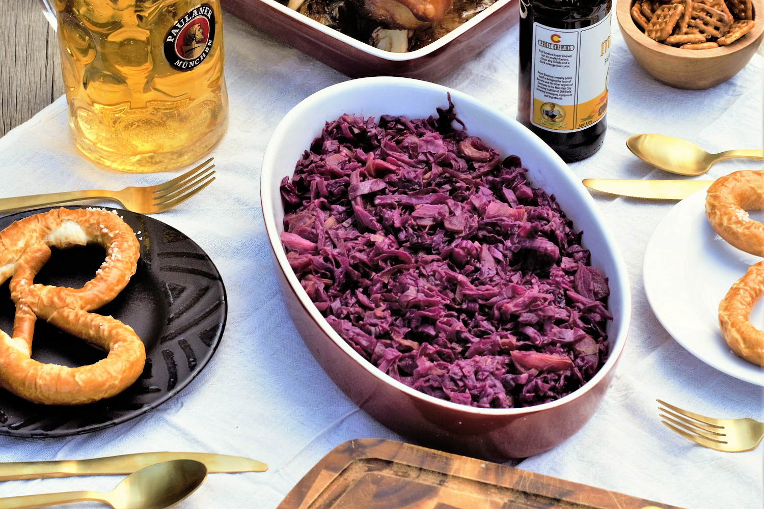 Sweet & tart rotkohl is the coziest fall vegetable dish! Red cabbage slow-simmers with apple slices, sweet onion, & cloves until the flavors marry together.