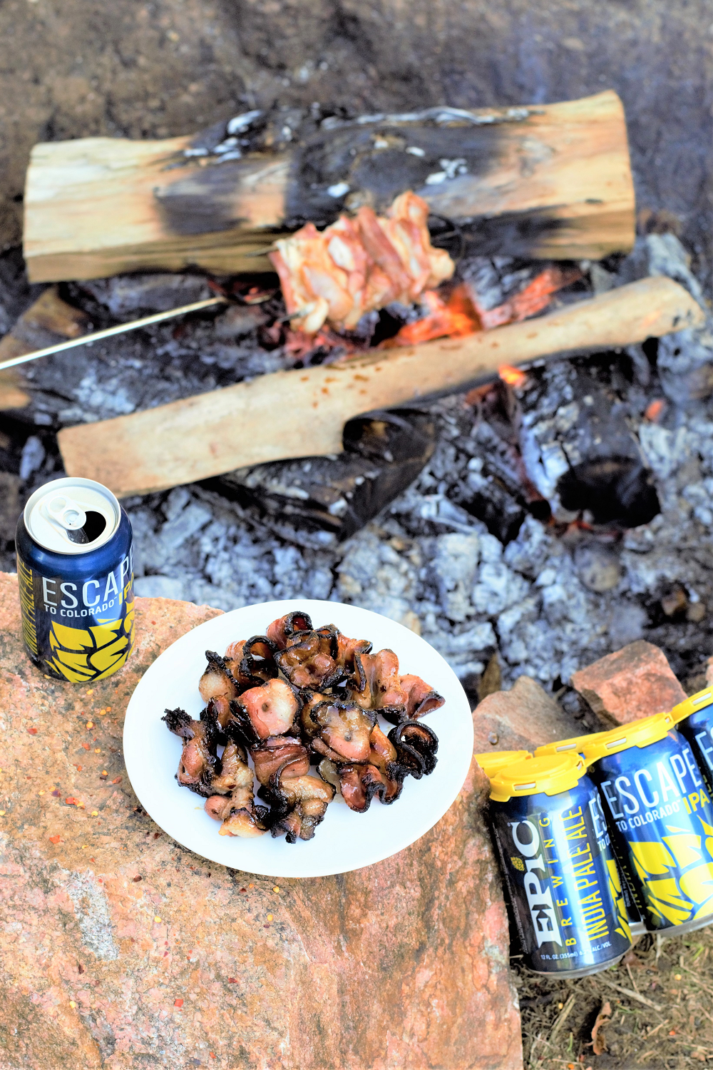 Thick slices of bacon are slathered with a spicy, sugary beer sauce and roasted over a smoky campfire for breakfast heaven!