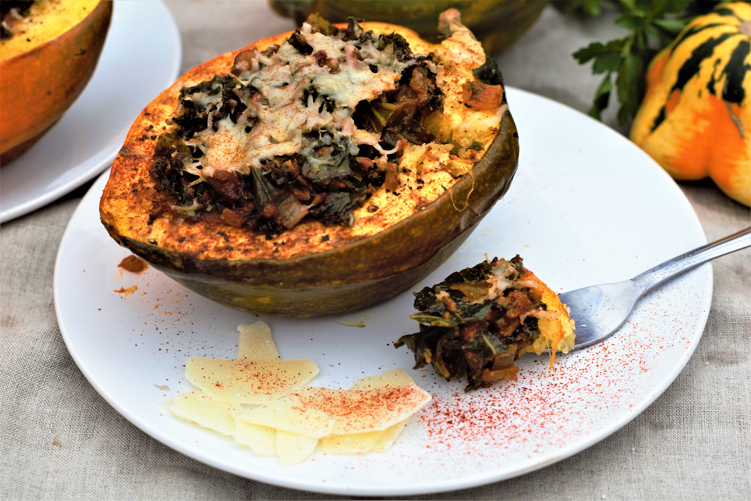 Acorn squash has sweet, nutty flesh that makes perfect individually-portioned bowls for lots of kale hidden in spicy, buttery chorizo.