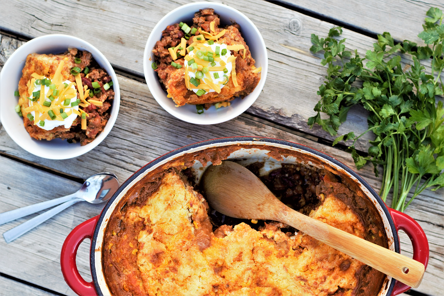 My forever-go-to comfort food chili, super thick and loaded up, made even better by baking creamy, corn-studded cornbread right on top.
