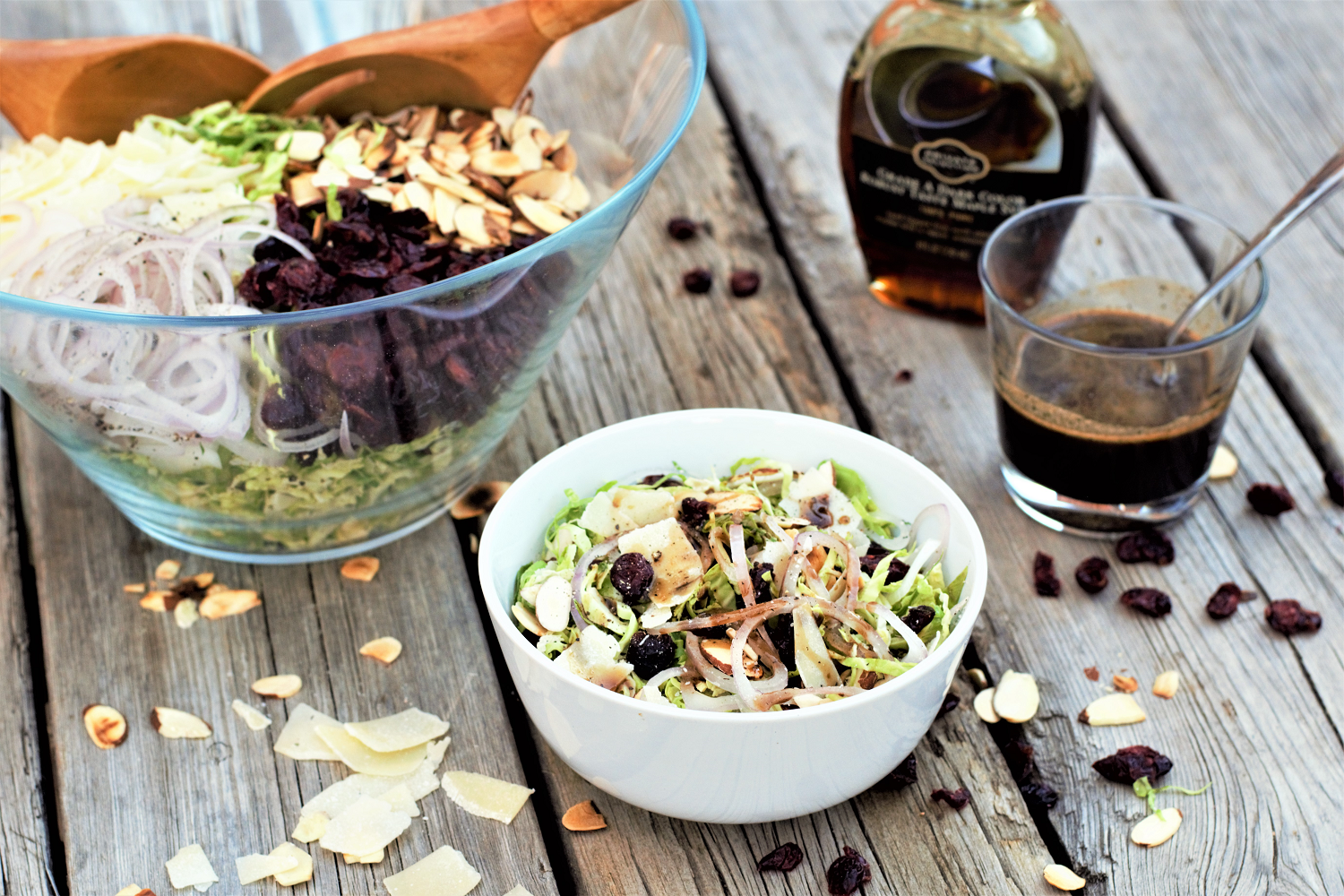 Brussels sprout salad with a little bit of everything: sweet cranberries, salty shaved parmesan, crunchy toasted almonds, & maple-balsamic vinaigrette.