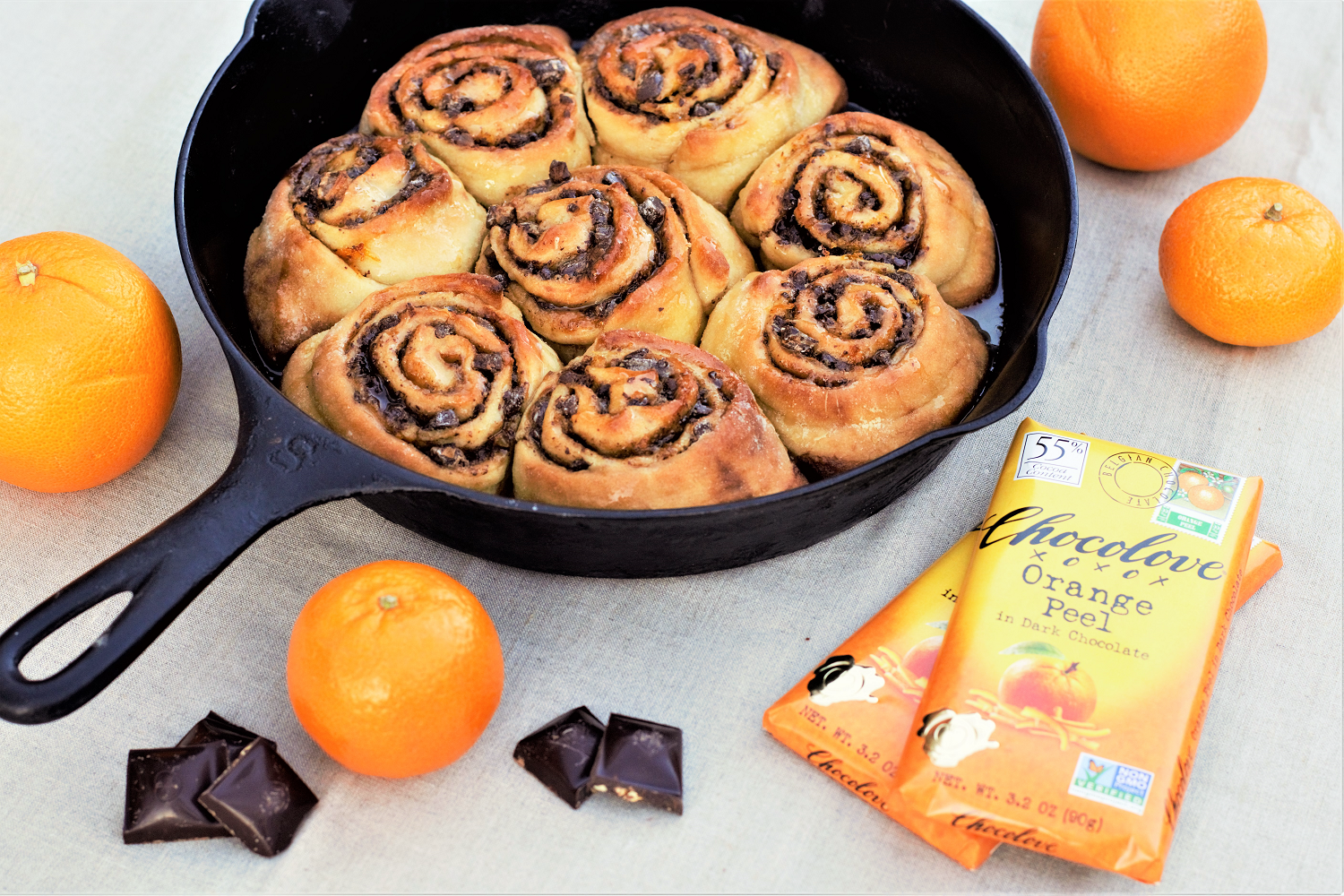 Warm up the oven on cozy, chilly mornings and start your day with soft dark chocolate, orange, & cardamom rolls with a sweet orange glaze.