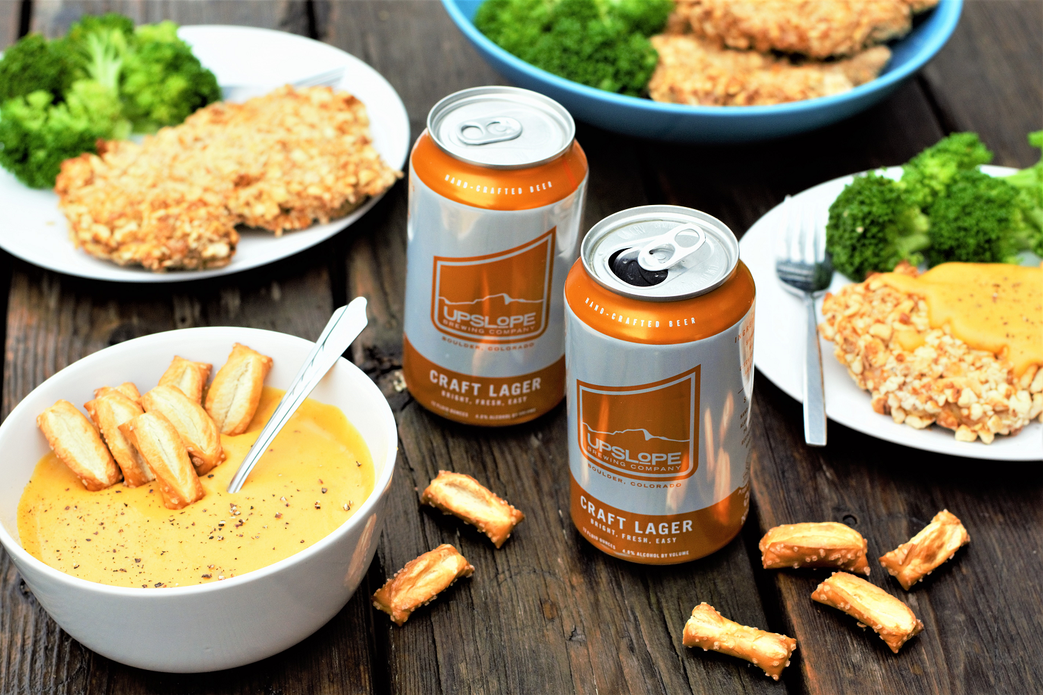Celebrating the love triangle of beer-pretzels-cheese: pretzel-breaded chicken baked to crispy perfection + drizzled with velvety smooth beer cheese!