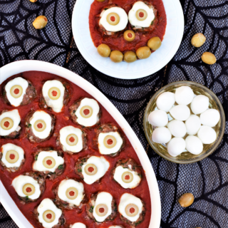 Kinda-gross, kinda-cute party appetizer couldn't be easier: mozzarella balls stuffed into meatballs, topped with olive 'eyes', & dished up on marinara.
