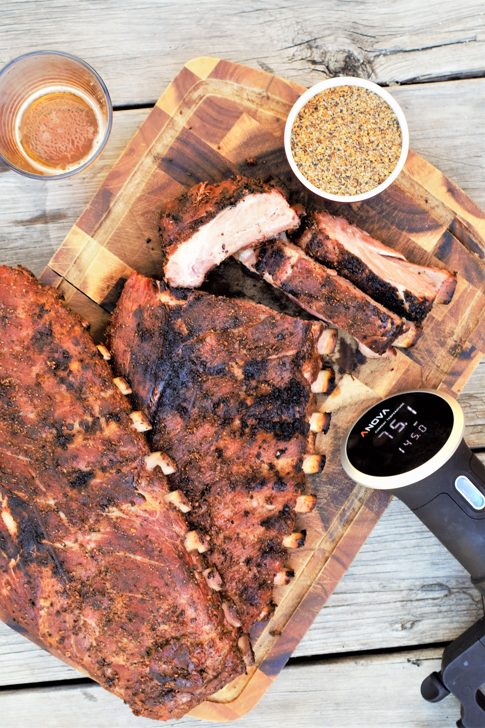 The secret to the very best ribs? Sous vide! Perfectly tender all the way through & seared over a blazing fire to create the perfect crusty bark.