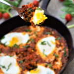 Flavor-bomb one-pan magic sauce: sweet cherry tomatoes fried 'til they burst in browned butter, finished with basil & eggs poached right in the skillet.