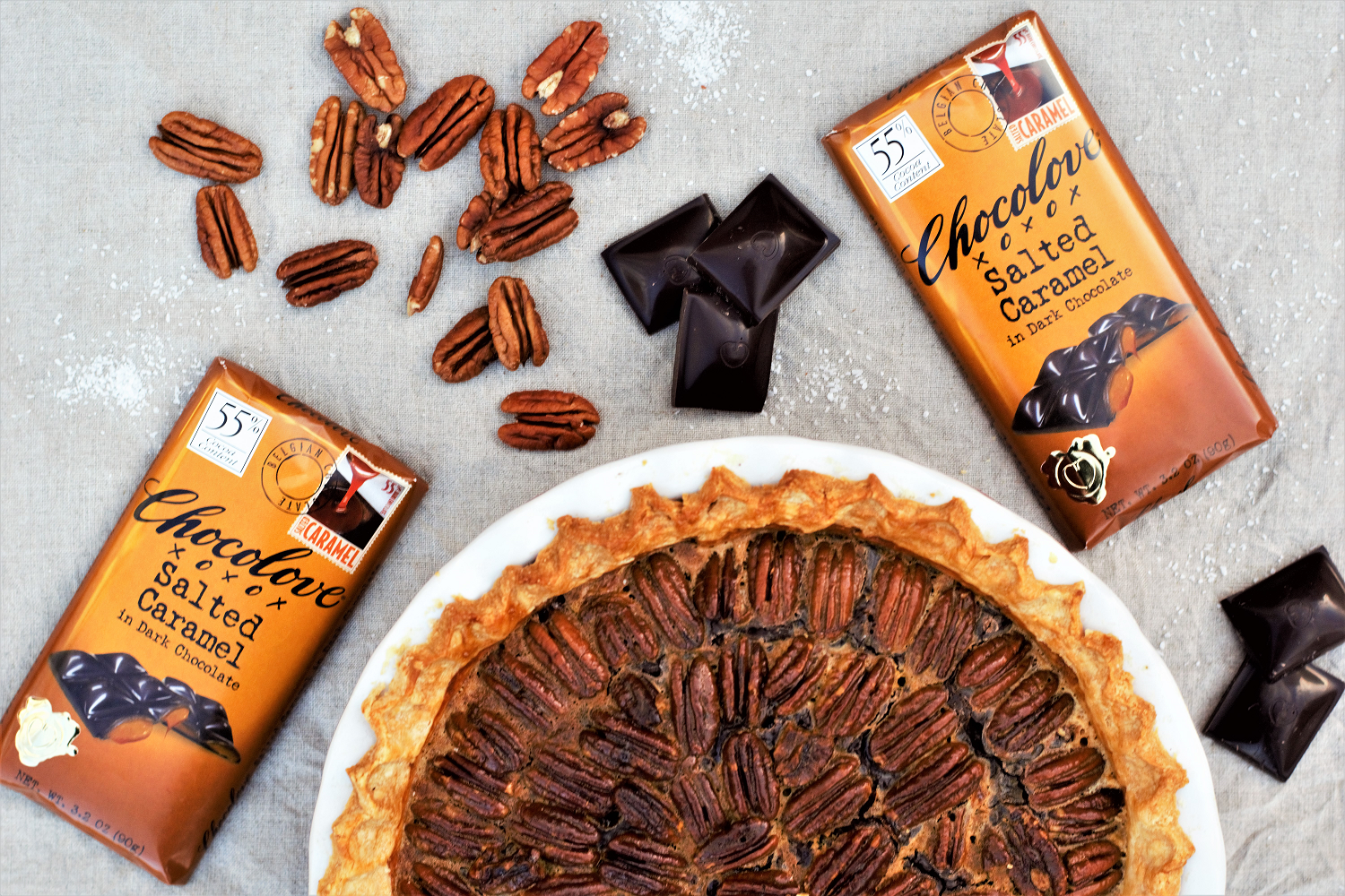 Toasted pecans, salted caramel, and rich dark chocolate layered inside a perfectly flaky pie crust for a new twist on a holiday favorite!
