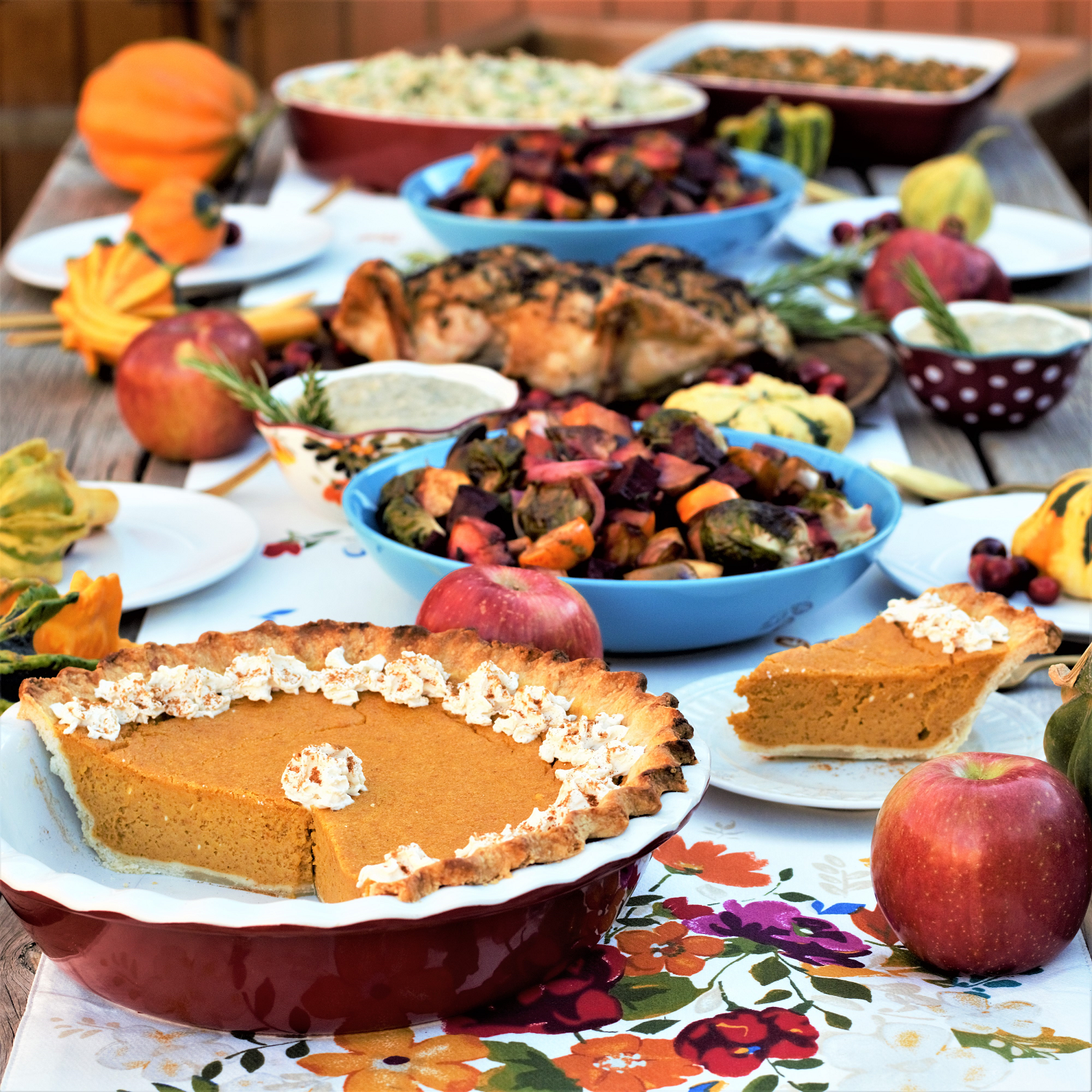 All-in-one guide for hosting a Friendsgiving feast: perfectly roasted chicken, garlic parmesan mashed potatoes, maple balsamic roasted veggies, & bourbon pumpkin pie!