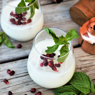 Simple 4-ingredient cocktail balancing rich, creamy coconut cream with bright fresh mint is perfect for whipping up at a last-minute holiday party!