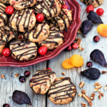 Dried fruits, chopped nuts, dark chocolate, and a hint of brandy shine in light & crunchy shortbread-style cookies - give fruitcake a chance this year!