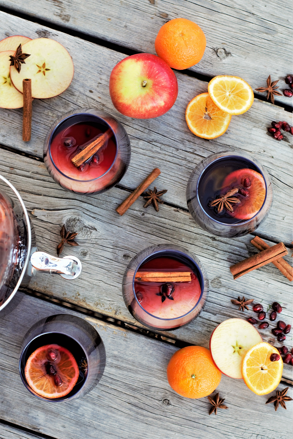 Winter sangria with red wine, apple cider, & triple sec creates a delicious, beautiful drink garnished with cinnamon sticks & star anise!