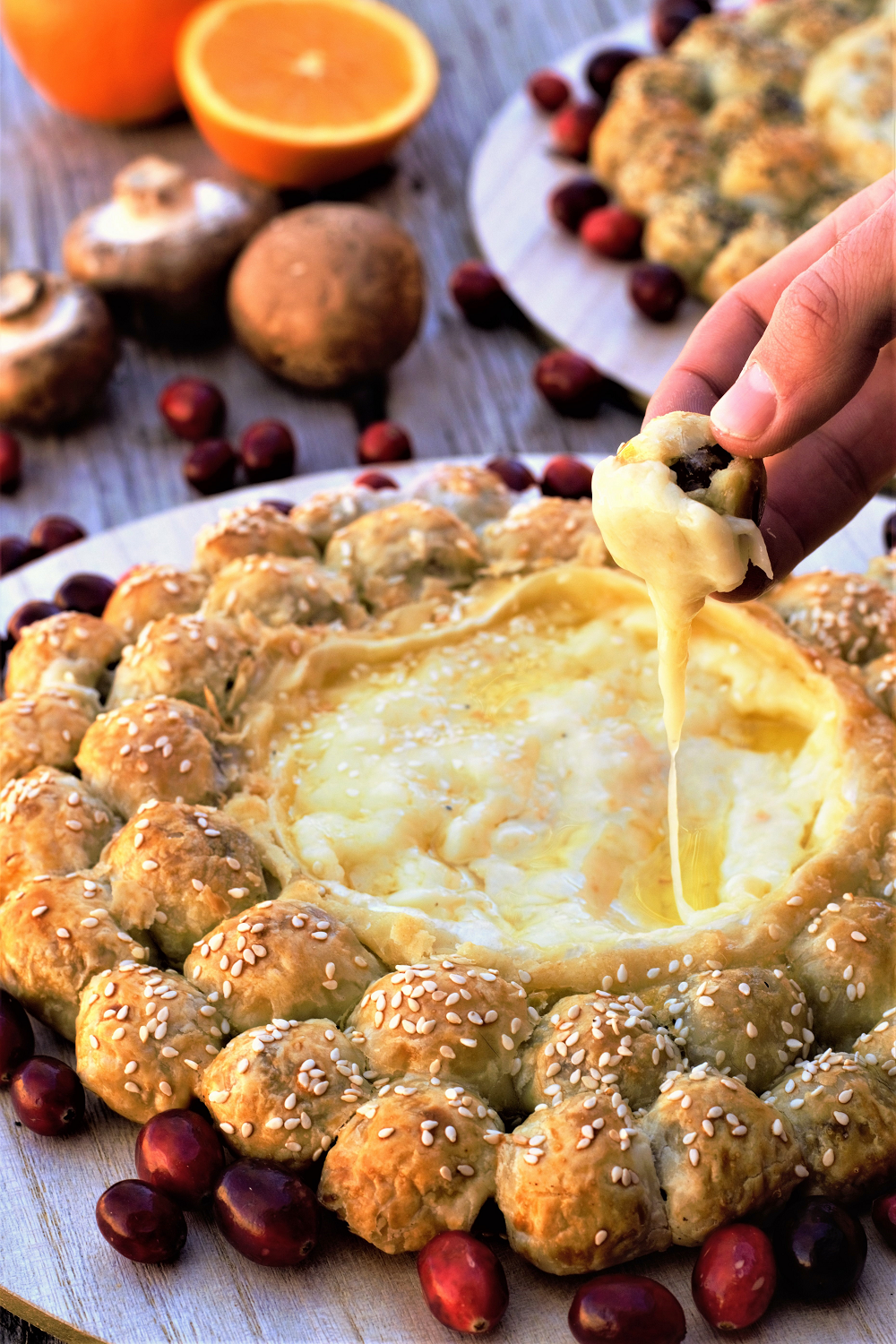 Crispy, flaky pastry bites stuffed with sausage, mushrooms, & caramelized onions, surrounding a whole wheel of gooey melted brie for dipping!
