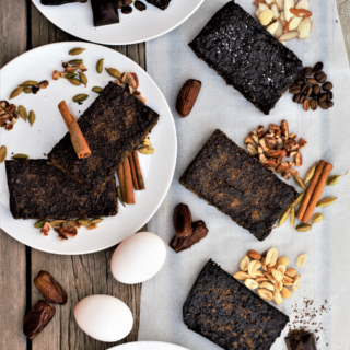 Healthy whole-food protein bars based on a simple formula of egg whites, nuts, & dates, made three ways: espresso chocolate, peanut butter chocolate, & vanilla spiced chai.