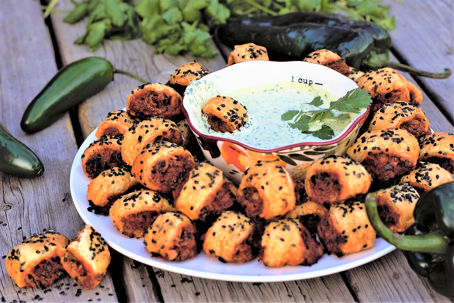 Crisp, flaky sausage rolls stuffed with a mixture of spicy chorizo & fresh poblano peppers paired with a super-simple cilantro lime dipping sauce - basically grown-up pizza rolls that are party ready for the weekend!