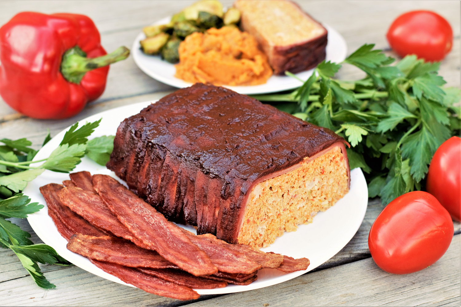 Healthy turkey meatloaf wrapped in turkey bacon is secretly stuffed with veggies, mixing cozy & familiar with healthy & fresh to satisfy all our comfort food cravings!