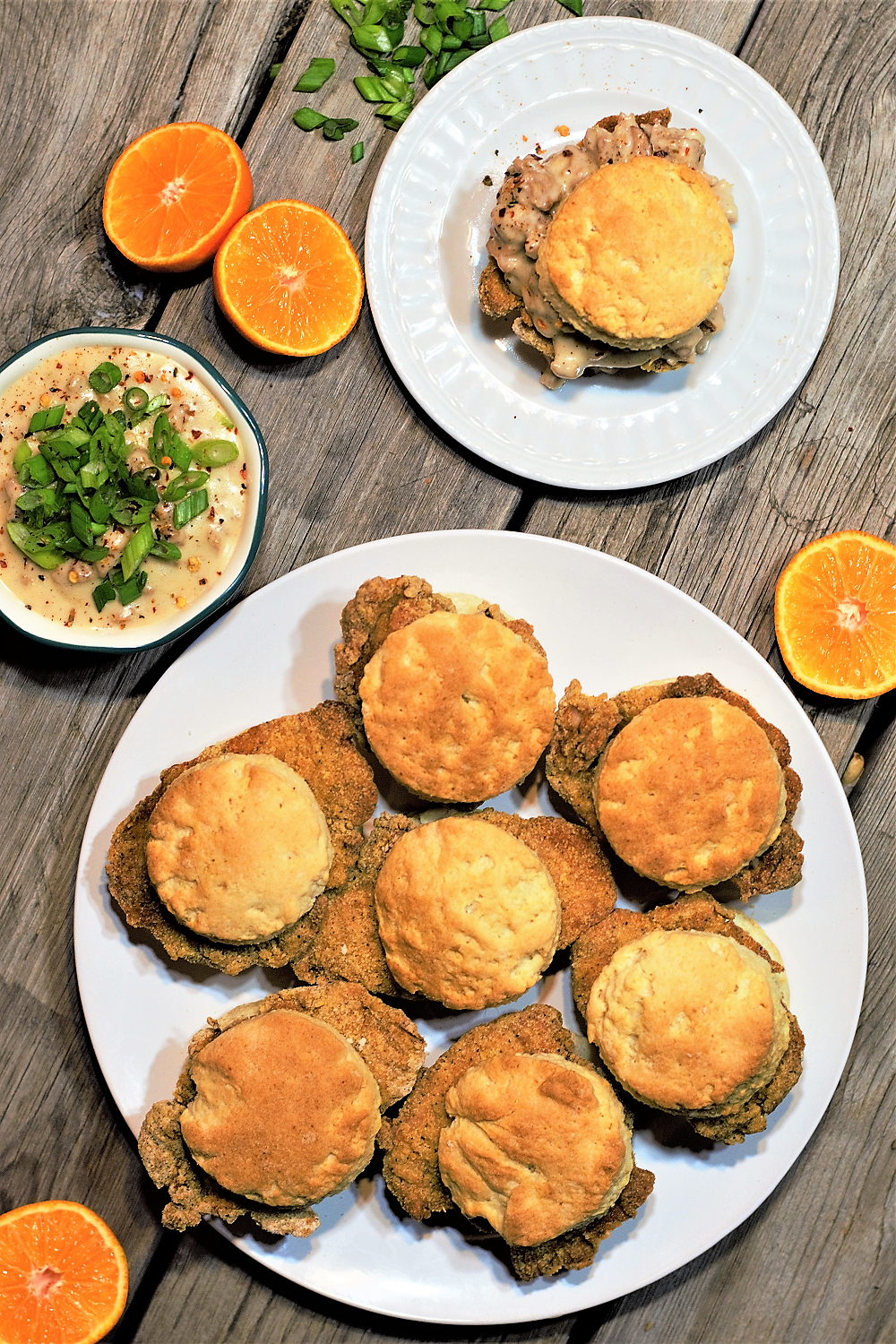 Step up your brunch game this weekend: juicy oven-fried chicken on flaky biscuits drowned in sausage gravy are the ultimate stuff-your-face comfort (or hangover) food!