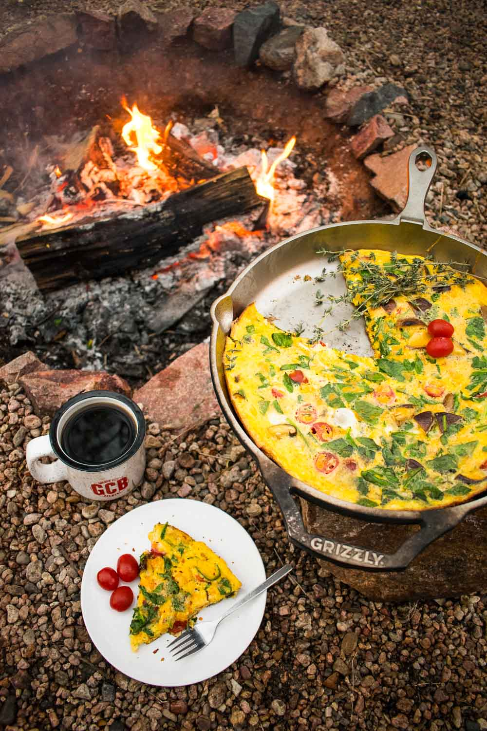 Easy crustless quiche is the perfect stress-free way to start a full day of adventures! Shake everything together in a bag at home, then just pour into a cast iron skillet set over the fire for a delicious camp breakfast.