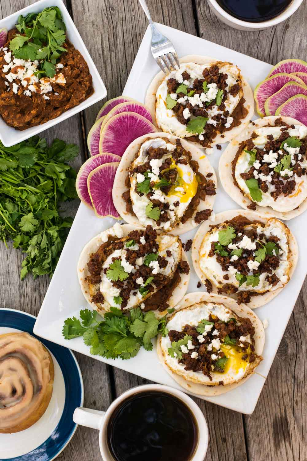 Spicy chorizo + smoky adobo refried beans + gooey fried eggs are perfectly paired for maximum morning happiness, whether it's weekend brunch or a weekday treat.