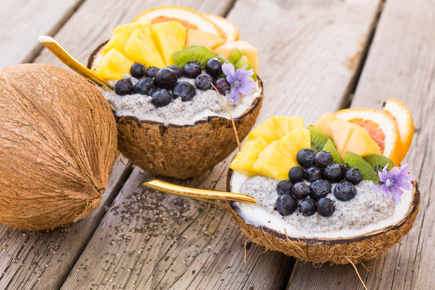 Naturally sweet overnight chia bowls loaded with coconut & your favorite fruit! Freshly cracked coconut bowls take this breakfast from weekday to weekend.