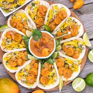 Spicy-sweet-crunchy-soft shrimp tacos are our summer anthem! Perfect excuse to marry Indian & Mexican with the bright, peppy flavors of mango & habanero.