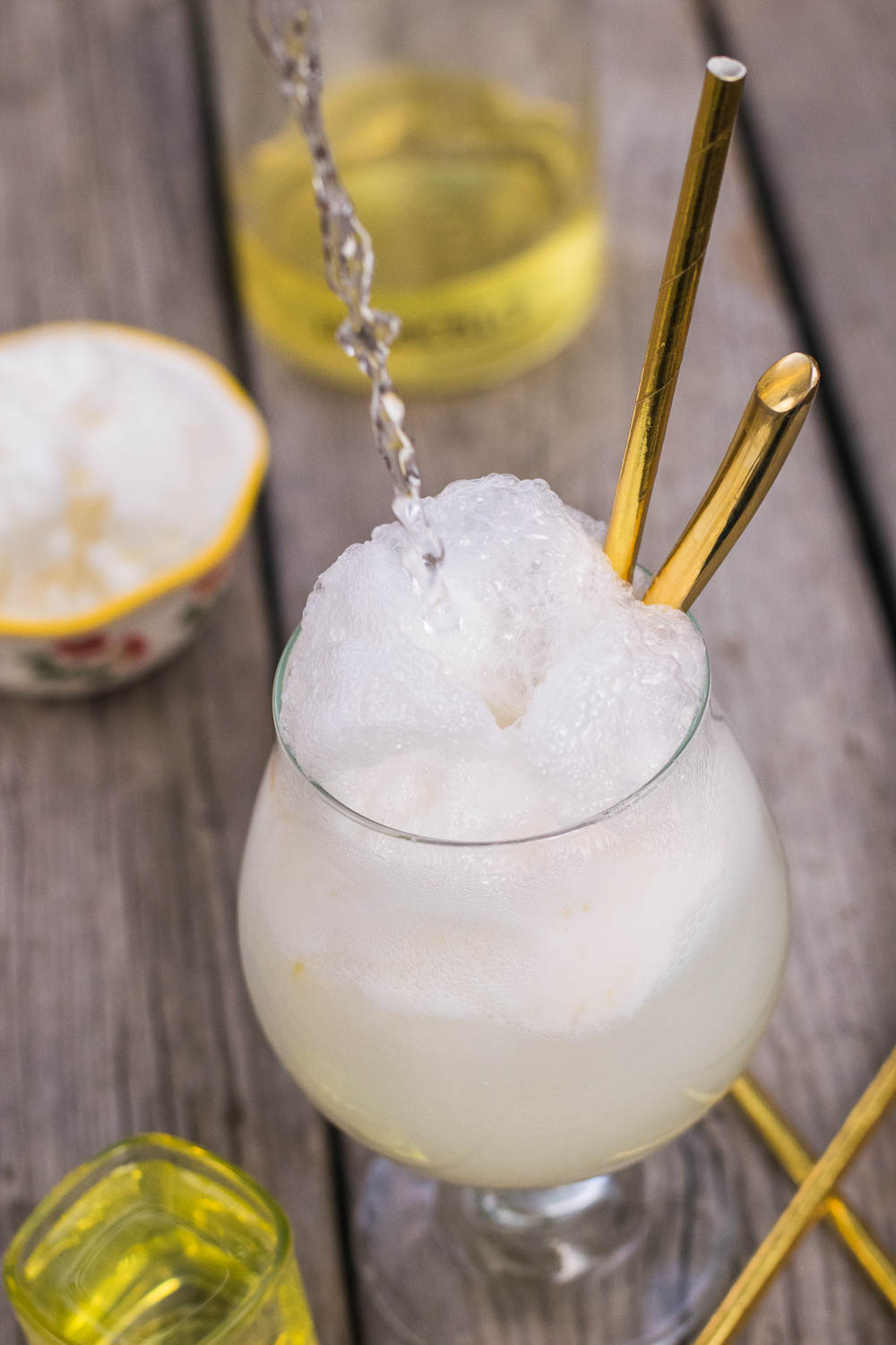 Enjoy the dog days of summer with a deliciously bubbly, wonderfully refreshing frozen treat of tart sherbet melting into sweet lemon liqueur! #limoncello #seltzer #dessert | mountaincravings.com