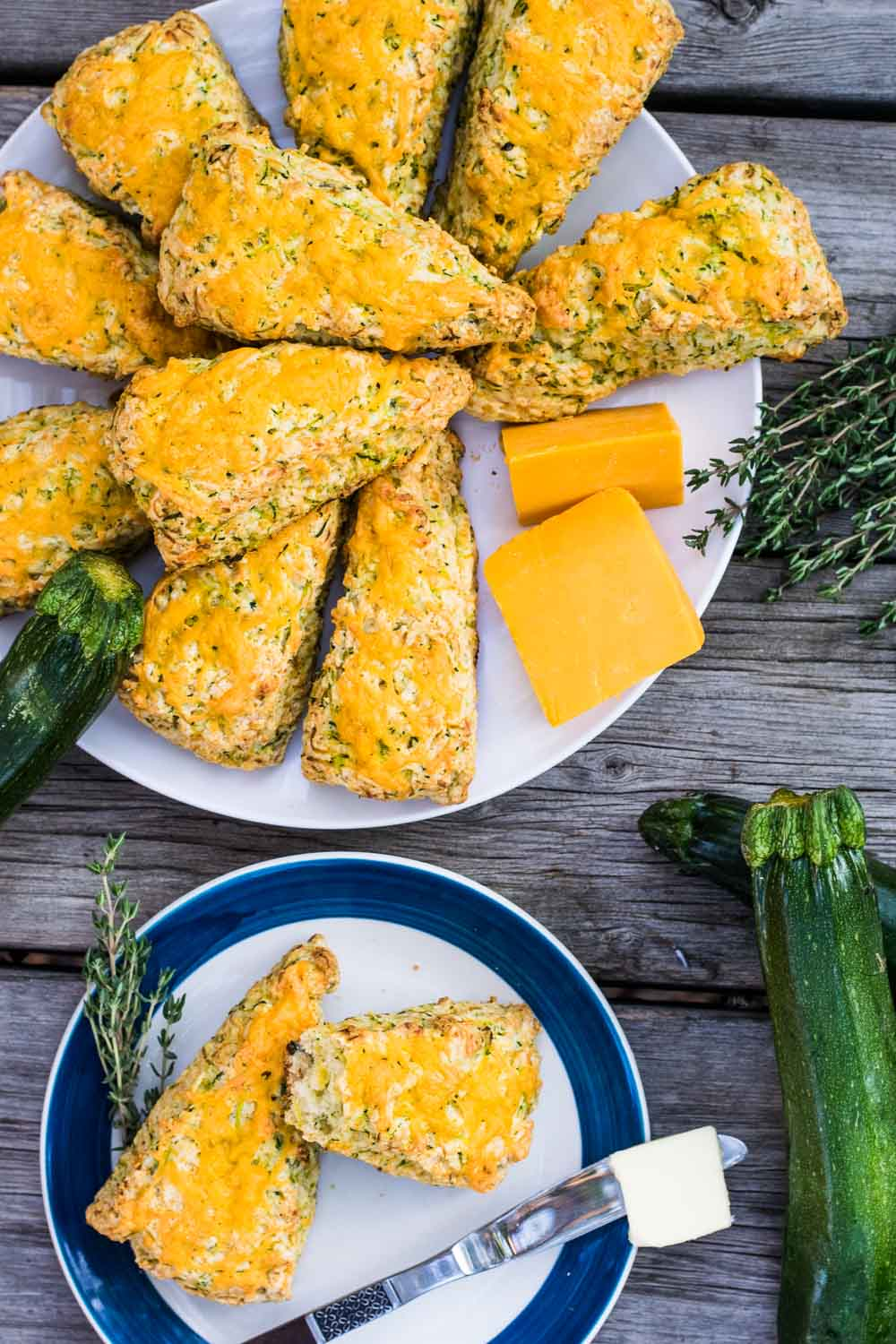 Delicious scones stuffed full of zucchini - so healthy! - and sharp cheddar, with a sprinkle of fresh thyme for good measure. Pop them in the oven tonight!