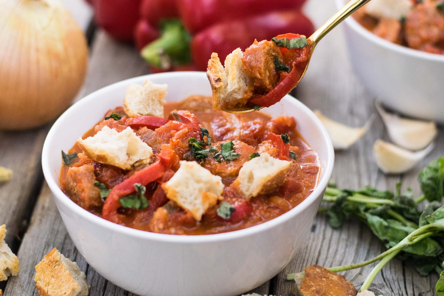 Embrace the cozy flavors of fall with a rustic stew of roasted red peppers, fresh basil, & sausage! Equally perfect for forest campsites & home kitchens.
