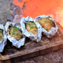 Who's ready for fall camping?! Make an easy camp dinner by stuffing hasselback potatoes full of cheese & topping them off with garlic butter!